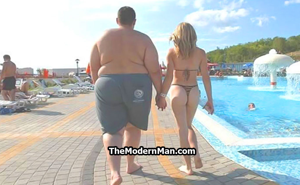 Fat guy with a skinny girlfriend at the pool