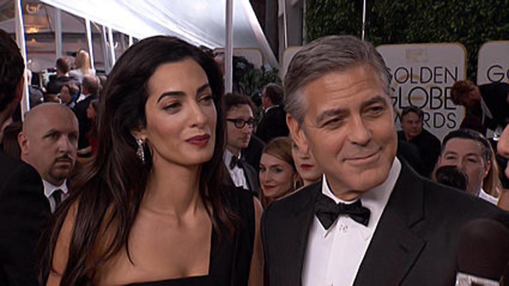 George Clooney - flirtatious smile