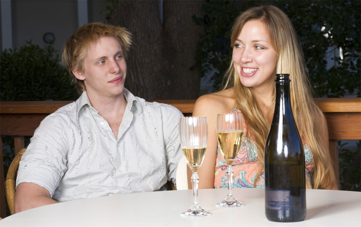 A man lacking confidence around a woman, even though she is sitting there having a drink with him.