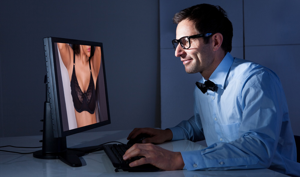 Man looking at porn. Men are mostly attracted to the physical appearance of women