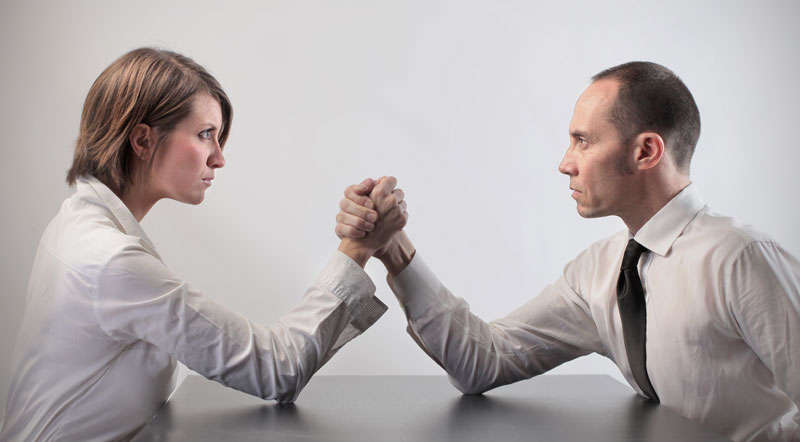 Woman and man about to arm wrestle