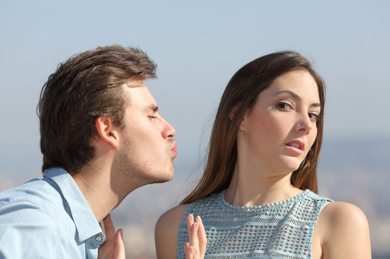 Woman pretending to reject a guy to test his confidence