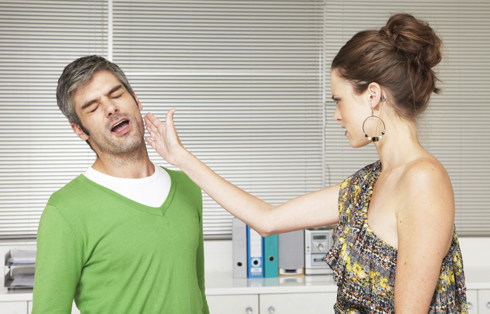 Woman slapping a man for giving her a compliment